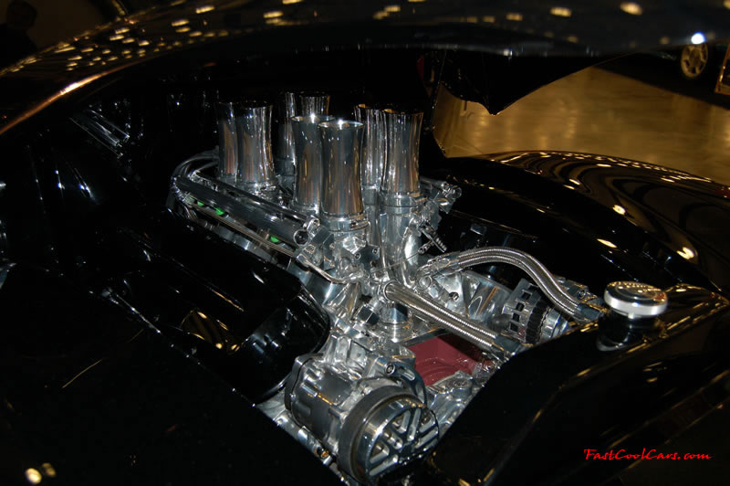 The 2009 World of Wheels Show in Chattanooga, Tennessee. On Jan. 9th,10, & 11th, Pictures by Ron Landry. Looks like 8 seperate fuel injectors velocity stacks, looks killer in the street rod. Wild ride.