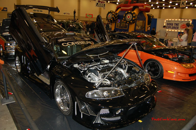 The 2009 World of Wheels Show in Chattanooga, Tennessee. On Jan. 9th,10, & 11th, Pictures by Ron Landry. Import with lambo doors and lots of wire wrapping under the hood. and a body kit to boot.