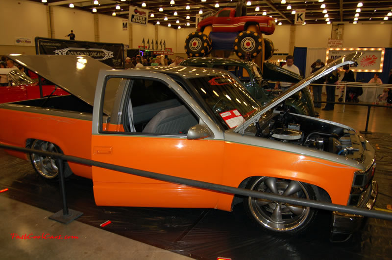 The 2009 World of Wheels Show in Chattanooga, Tennessee. On Jan. 9th,10, & 11th, Pictures by Ron Landry. Low rider Lil' truck with custom rims, and a two tone paint job. Orange and silver.