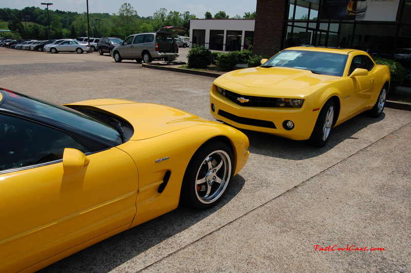 2010 Chevrolet Camaro 2LT and 2002 Supercharged Z06 Corvette, both in yellow.