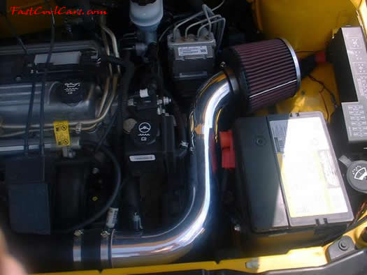 2002 Chevrolet Cavalier nice Yellow paint, chrome wheels, dropped chrome intake tube with K&N cone filter