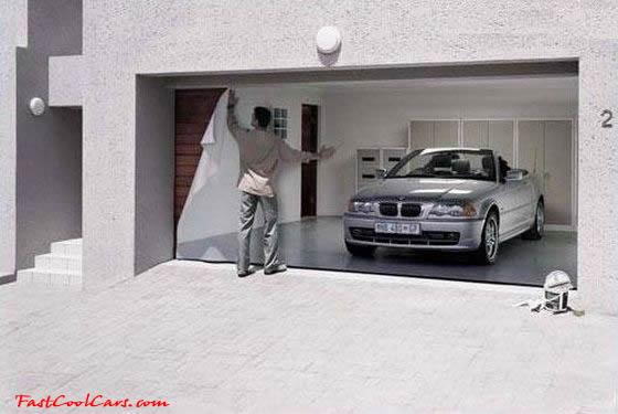 Applying the garage door decal to the garage door.
