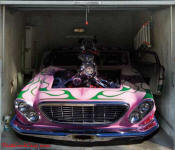 Custom painted tricked out blown car, on garage door decal.