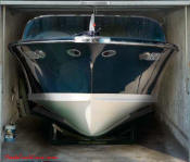 Huge nice boat with cubby compartment, on garage door decal.