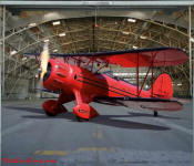 Bi-plane in hanger, on garage door decal.
