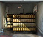 Two pallets of gold bars, on garage door decal.