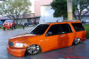 Lowrider Blazer that has been lowered, dropped, slammed, and scraping, using many different modifications.