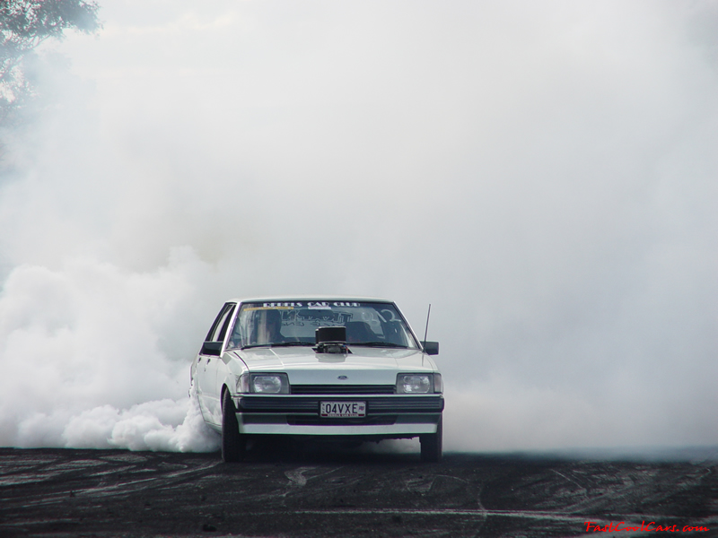1983 Ford Falcon right hand drive with huge engine sticking out of the hood, great burnout.